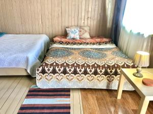 """A bed or beds in a room at """"Солнечная горка"""""""