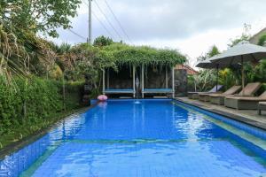 The swimming pool at or near Koji Garden Huts