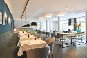 Ein Restaurant oder anderes Speiselokal in der Unterkunft Ringhotel VITALHOTEL ambiente