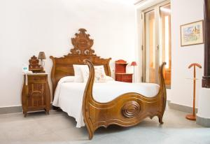 A bed or beds in a room at Les Monges Palace Boutique