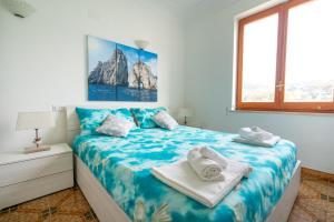 A bed or beds in a room at Casa Nonna Marta