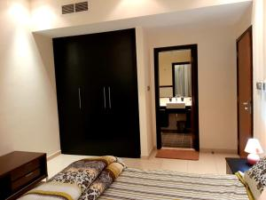 A bed or beds in a room at Private rooms in 3 bedroom apartment sky nest home sky view tower
