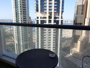 A balcony or terrace at Private rooms in 3 bedroom apartment sky nest home sky view tower