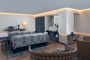 A bed or beds in a room at Hard Rock Hotel Bali