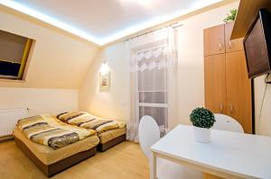 A bed or beds in a room at Studio16