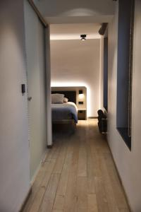 A bed or beds in a room at Airfield - Airport