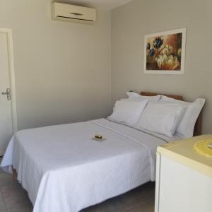 Cama o camas de una habitación en Pousada Lara