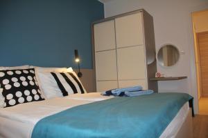 A bed or beds in a room at Villa Elizabeta