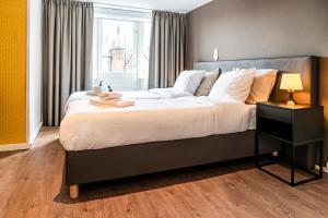 Een bed of bedden in een kamer bij Hotel Brasserie de Huifkar