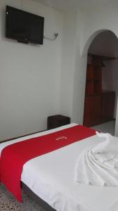 Un ou plusieurs lits dans un hébergement de l'établissement Hotel Villa Ricaurte