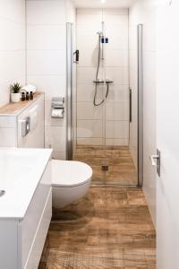 Een badkamer bij Hotel Brasserie de Huifkar
