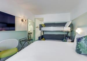 A bunk bed or bunk beds in a room at Mercure Paris Orly Tech Airport