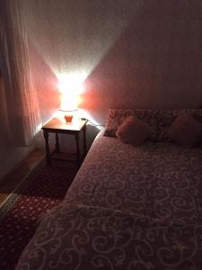 A bed or beds in a room at Apartman Bane Rab