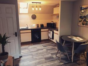 A kitchen or kitchenette at Clarabel's Guest House- The Cranny