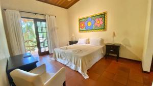 Cama ou camas em um quarto em Duplex Girassóis Pipa