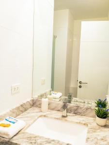 A bathroom at Departamento de playa - Condominio OCEAN REEF - SAN BARTOLO