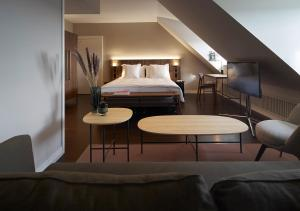 Ein Bett oder Betten in einem Zimmer der Unterkunft Sorell Hotel Zürichberg