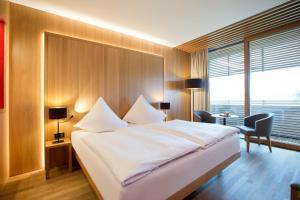 Кровать или кровати в номере Hotel Schwärzler