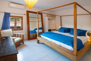 Ein Bett oder Betten in einem Zimmer der Unterkunft La Masía de Formentera