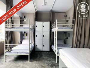 A bunk bed or bunk beds in a room at Su Taichung Hostel