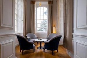 A seating area at Fowey Hall - A Luxury Family Hotel