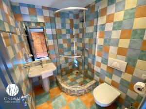 Koupelna v ubytování Hotel Ondras z Beskyd