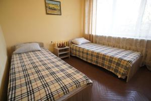 Кровать или кровати в номере Дом Отдыха Компонент
