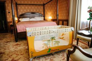 Кровать или кровати в номере Президент-Отель