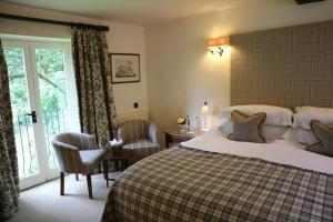 A bed or beds in a room at The Bay Tree Hotel
