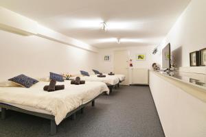 Een bed of bedden in een kamer bij Leidseplein-Amsterdam Centre