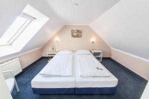 Hotel an der Kö Düsseldorfにあるベッド