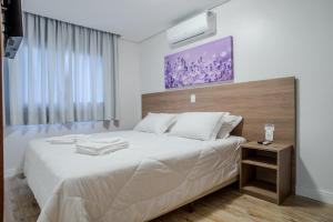 A bed or beds in a room at Monte Felice Stay - Parque da Vinícola