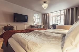 Säng eller sängar i ett rum på Hotel Poseidon