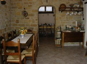 A restaurant or other place to eat at Azienda Agrituristica Colle San Giorgio