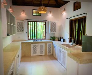 A kitchen or kitchenette at Tisara Villas