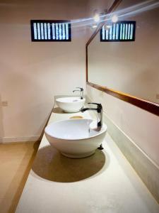 A bathroom at Tisara Villas