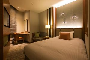 A bed or beds in a room at Highland Resort Hotel & Spa