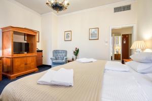 Кровать или кровати в номере Hotel Europa