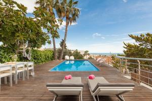 The swimming pool at or near Miramar Sitges