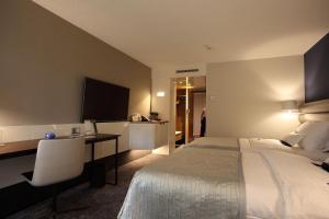 Ein Bett oder Betten in einem Zimmer der Unterkunft Mövenpick Hotel Lausanne