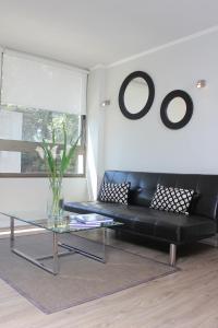 Uma área de estar em Apart Hotel Providencia