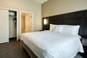 A bed or beds in a room at Residence Inn by Marriott Harrisburg North