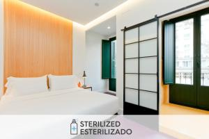 A bed or beds in a room at SLEEP'N Atocha - B Corp Certified