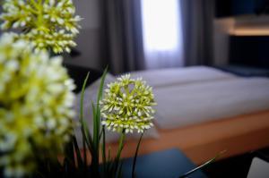 Ein Bett oder Betten in einem Zimmer der Unterkunft Pension Elisabeth
