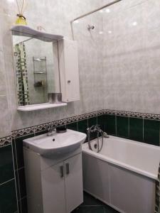 A bathroom at Апартаменты. Ярославское шоссе 500 м.