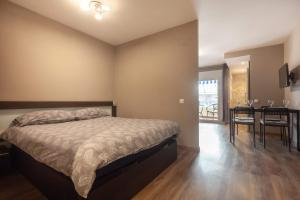 A bed or beds in a room at Studio Alboran