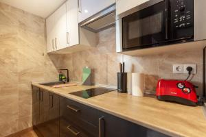 A kitchen or kitchenette at Studio Alboran