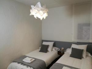 A bed or beds in a room at El Paller de Can Puig a la Pera 4/6 pax