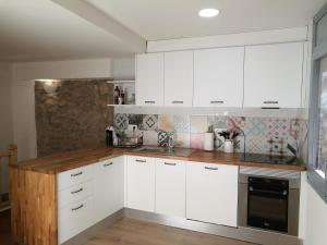 A kitchen or kitchenette at El Paller de Can Puig a la Pera 4/6 pax