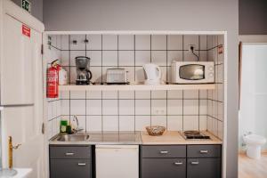 A kitchen or kitchenette at ASPA - Alegria Studios